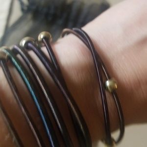 Jewelry - Cute springy with beads set of 8 guitar bracelets